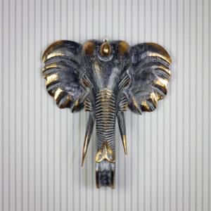 Figura elefante tallada a mano para pared, de 50x45cm y acabado en madera con decapado negro y pan de oro