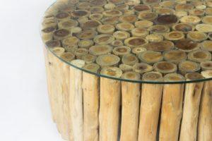 Mesa redonda de café con cristal de troncos de madera. 105cm